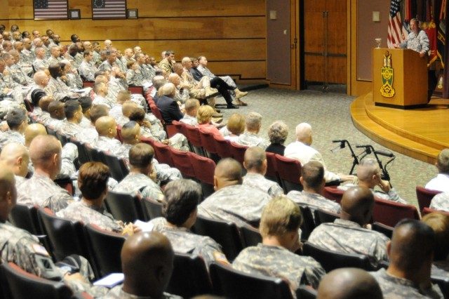 FORT BLISS, Texas - Sergeant Major of the Army Kenneth Preston addresses Sergeants Major Course Class 59 in the U.S. Army Sergeants Major Academy East Auditorium during opening ceremonies Aug. 8, marking the official start of the nine month senior enlisted course.