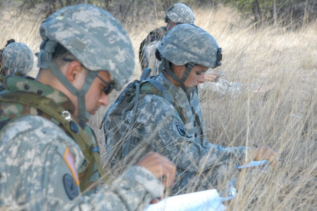 Sgt. Lisa Morales, 11th Signal Brigade, and fellow competitors kneel to write a warning order during the Network Enterprise Technology Command/9th Signal Command  noncommissioned officer of the year competition June 18. Morales won NCO of the year and went on to become the first female NETCOM Soldier to win Forces Command NCO of the Year.