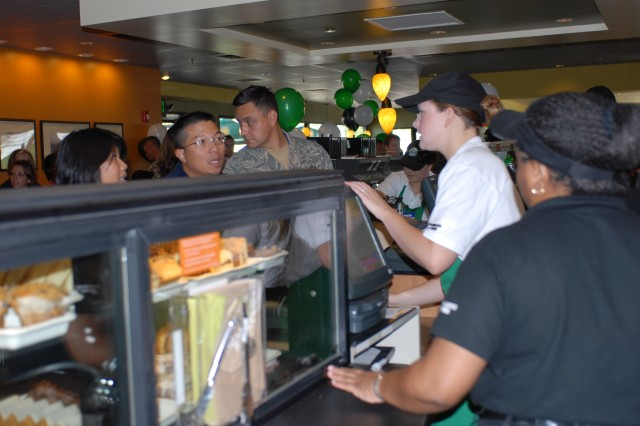 Starbucks associates take orders immediately after the store's grand opening Monday, August 11, 2008, at the National Training Center and Fort Irwin, Calif. Housed in a former fast food building, the new Starbucks has 3,500 square feet of selling space and offers free Wi-Fi. According to Renee Ellis, general manager, Fort Irwin Exchange, Army and Air Force Exchange Service, the store is the largest free-standing Starbucks that AAFES owns in the continental United States.