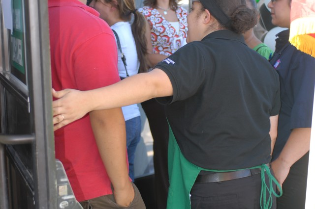 Customers line up to enter Starbucks immediately after the store's grand opening Monday, August 11, 2008, at the National Training Center and Fort Irwin, Calif. Housed in a former fast food building, the new Starbucks has 3,500 square feet of selling space and offers free Wi-Fi. According to Renee Ellis, general manager, Fort Irwin Exchange, Army and Air Force Exchange Service, the store is the largest free-standing Starbucks that AAFES owns in the continental United States.