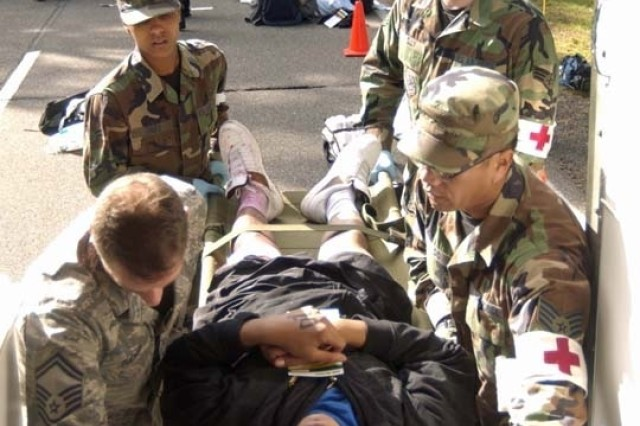 """Medical technicians with the Ramstein Air Base 435th Air Medical and Dental Squadron load a """"victim"""" into an ambulance during the U.S. Army Garrison Kaiserslautern's Warrior Response 2008 force protection exercise held Aug. 9 in Germany."""