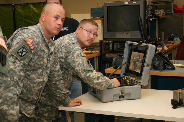 Soldiers are operating a Talon robot manufactured by Foster-Miller. AMRDEC is developing computer-aided technologies to improve small robots, like Talon, that are used in the defeat of IEDs.  The technology is being developed in the Battlefield Automation Lab of the Software Engineering Directorate.