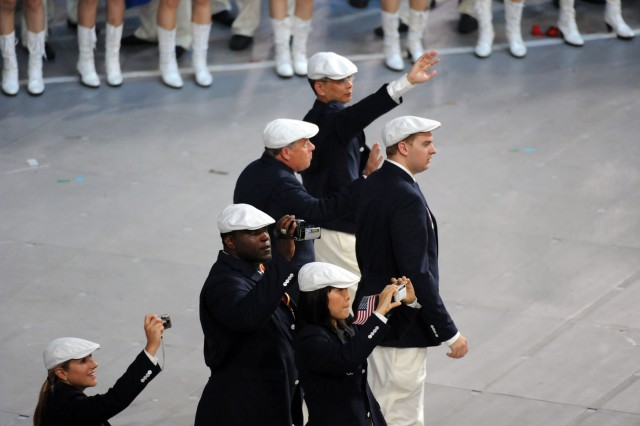 Army World Class Athlete Program Greco-Roman wrestler Staff Sgt. Dremiel Byers (second from left) videos the sights and sounds of Team USA's march around the Bird's Nest during the Opening Ceremony of the 2008 Summer Olympic Games Aug. 8 in Beijing. Byers, a 2002 World Champion, will compete Aug. 14.