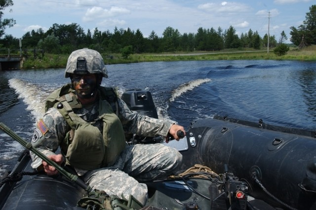 Sgt. Nicholas Joellenbeck, the 739th Engineer Company Multi Role Bridge assistant noncommissioned officer in charge, drives the raft doing reconnaissance in the area before a bridge is laid down July 19 during Exercise Patriot Warrior at Fort McCoy. This raft will also provide security when the bridge is being built.
