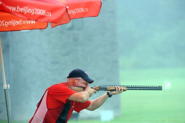 U.S. Army Sgt. 1st Class (ret.) Bret Erickson shoots through the rain to a four-way tie for 21st place in the men's trap event in the 2008 Olympic Games Aug. 10 in Beijing.