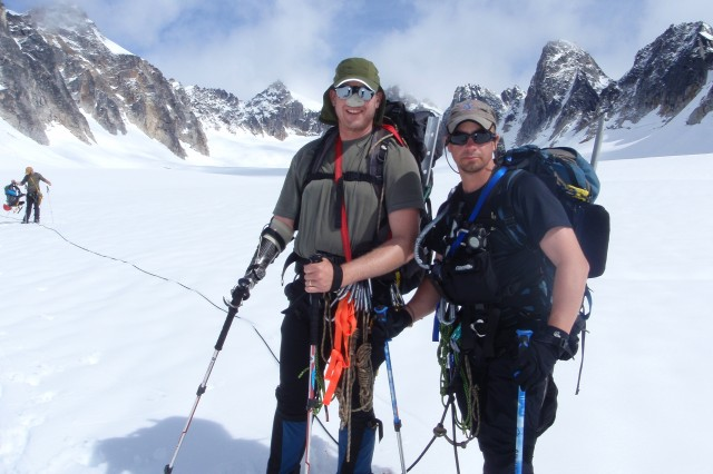 Retired U.S. Marine Corps Capt. Jon Kuniholm (left) and Army Maj. Marc Hoffmeister pause during roped team movement on Pika Glacier.