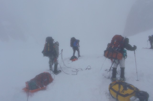 The team moves camp in a storm in an area of Denali National Park known as Aca,!EoeLittle SwitzerlandAca,!a,,c where they trained on mountaineering skills with the Alaska Mountaineering School.