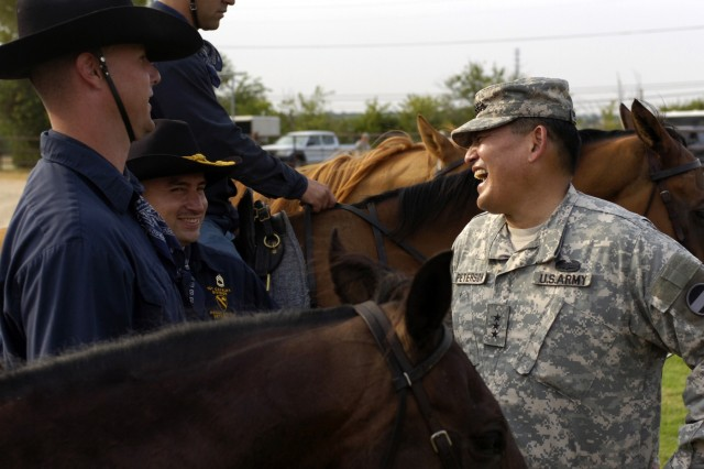 Honolulu, Hawaii native Lt. Gen. Joseph F. Peterson, deputy commanding general/chief of staff, United States Army Forces Command, thanks Soldiers from the 1st Cavalry Division, Horse Cavalry Detachment, at the conclusion of his ride on Fort Hood Texas, Aug. 12. Peterson became the deputy commanding general, chief of staff, United States Army Forces Command, in 2006.  Forces Command trains, mobilizes, deploys, sustains, transforms and reconstitutes conventional forces numbering approximately 780,000 Soldiers.