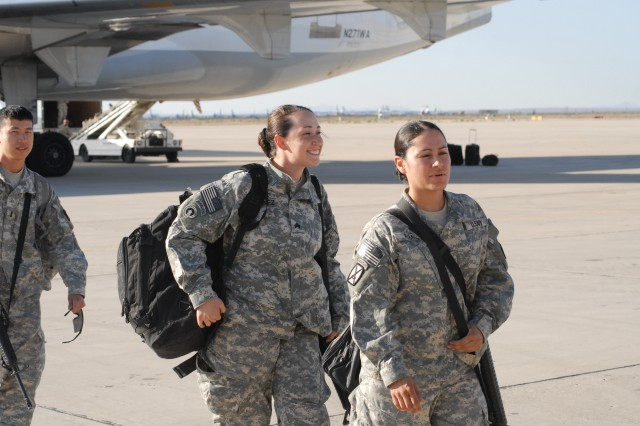 Sgt. Teri Martinez, left, and Sgt. Maribel Ramos, 2nd Heavy Equipment Transportation Company, Echelons Above Brigade Support Battalion, National Training Center Support Brigade, NTC and Fort Irwin, Calif., redeployed Aug. 6, 2008, after a 15-month deployment in Kuwait.