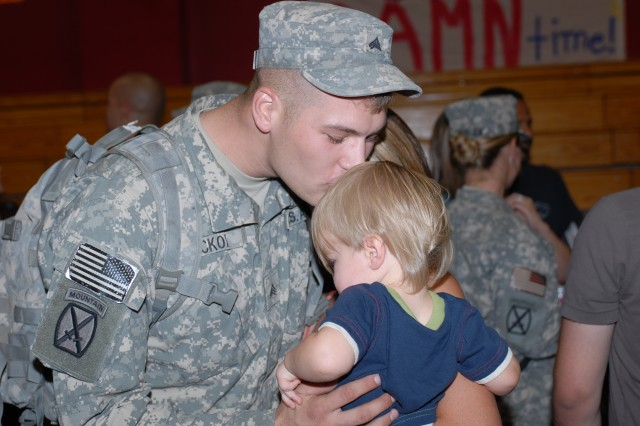 Sgt. Cory Hickox, 2nd Heavy Equipment Transportation Company, Echelons Above Brigade Support Battalion, National Training Center Support Brigade, NTC and Fort Irwin, Calif., greets his son, Aiden, 13 months, after the 2nd HET's redeployment ceremony. The 2nd HET returned to NTC and Fort Irwin Aug. 6, 2008 after a 15-month deployment in Kuwait.