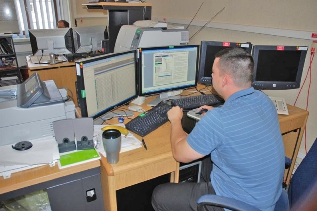 Jerod Young, an analyst in the Current Operations Cell, examines data during a computer defense action in Europe.