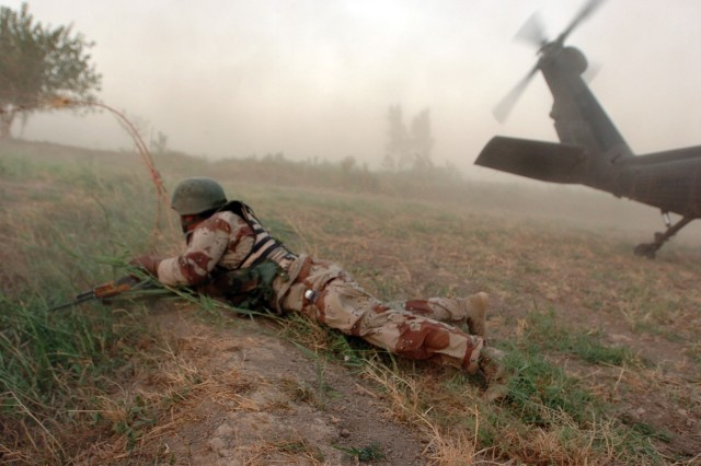 An Iraqi Army Soldier with 4/1/23/17th IA Div. pulls security after dismounting a UH-60 Black Hawk during Operation Kips Bay, a combined air assault in Al Betra, approximately 30 kilometers southwest of Baghdad, Aug.8.