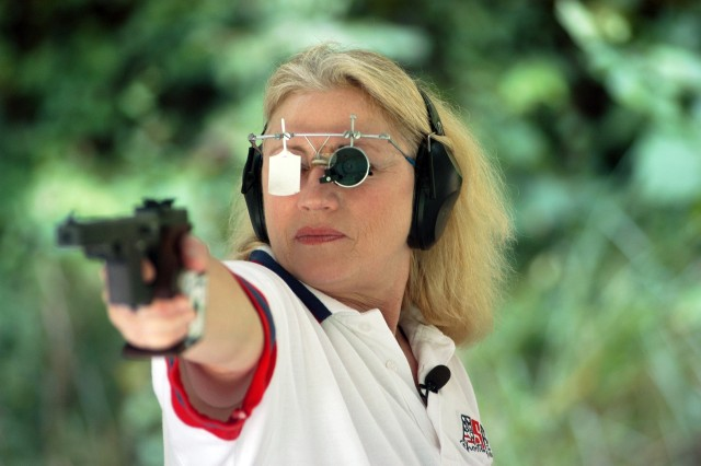 "U.S. Army Reserve Staff Sgt. Elizabeth Aca,!A""LibbyAca,!A? Callahan, 56, of Columbia, S.C., trains here to compete in her fourth Olympics in the womenAca,!a,,cs 25-meter sport pistol event."