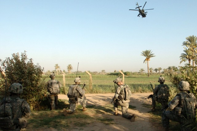 Soldiers with Co. A, 3-187th Inf., 3rd BCT, 101st Abn. Div. (AASLT) prepare to go to the pickup zone during Operation Kips Bay, a combined air assault in Al Betra, about 30 kilometers southwest of Baghdad, Aug.8.