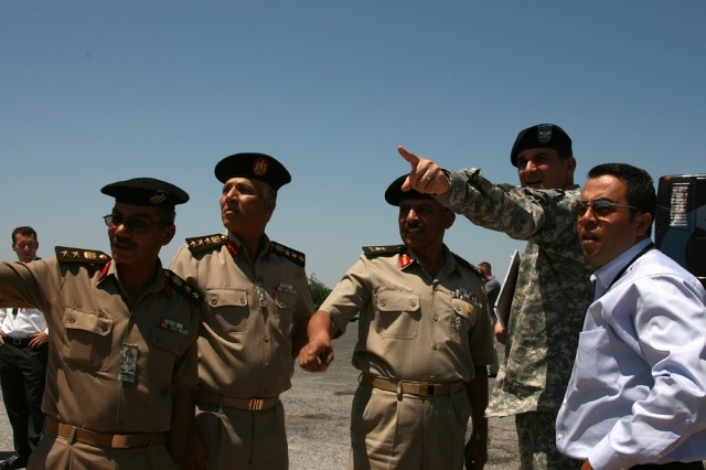 Col. Sam White, post chief of staff (second from right), points out local landmarks from the top of Mount Scott to Col. Ehab Mohamed Raft Mohamed Fasike, Brig. Gen. Moussa Mahmoud Elbahnasy and Maj. Gen. Abdel Megeed Ahmed Abdel Megeed Sakr, all of the Egyptian Staff War College. The group visited Fort Sill for the International Artillery Symposium Aug. 4 through 6.