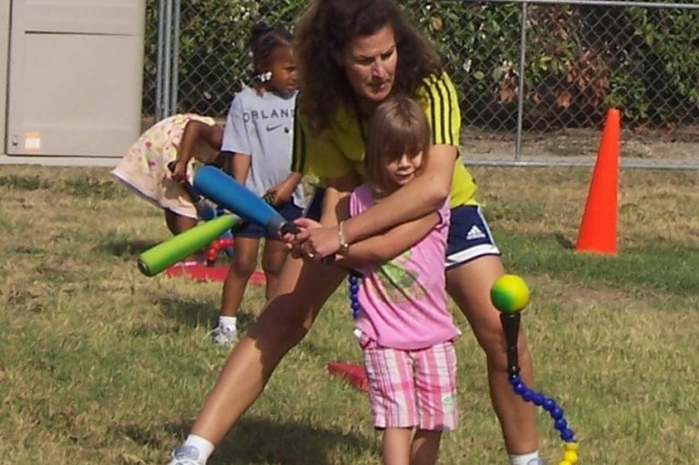Jill Marcott coaches children in T-ball at the Child Development Center. Marcott is the CDC's teacher and coach for the Start Smart Sports Development Program.