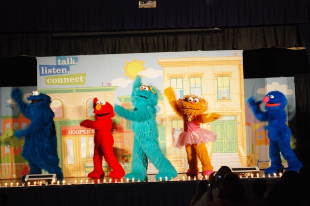 "The furry cast of the Sesame Street Experience, Cookie Monster, Elmo, Rosarita, Zoe and Grover, dance and sing their way across the stage Aug. 11 at the Fort Sam Houston Army Community Service center. The Sesame Workshop and United Service Organizations partnered to bring ""The Sesame Street experience for Military Families"" to installations across the country. The free, traveling tour offered resources for military Families with young children, who are experiencing the effects of deployments of parents."