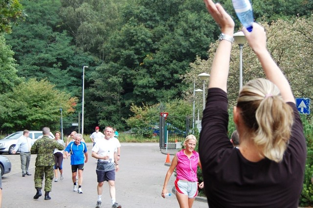 Runners are cheered to the finish of a Terry Fox Run held in 2007. A run held in Selfkant-Kaserne Niederheide, Germany, this year is open to the public. All other events this year are open to NATO ID cardholders.