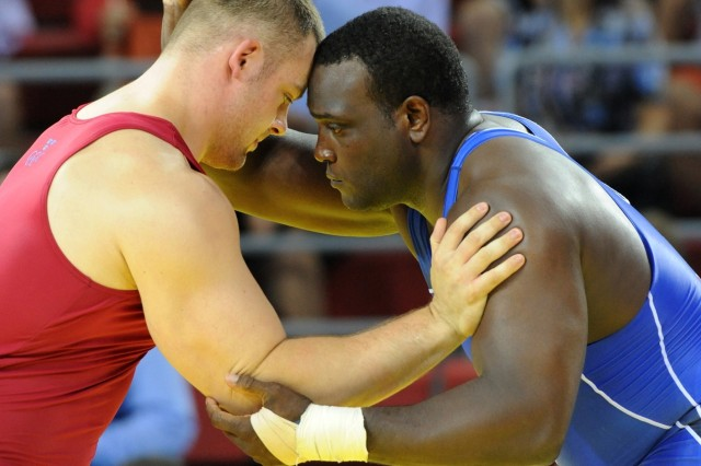"Army World Class Athlete Program Staff Sgt. Dremiel Byers (right) vows to wrestle for a berth in the 2012 London Games after losing to Sweden's Jalmar Sjoberg (left) in the Olympic Greco-Roman 120-kilogram quarterfinals Aug. 14 at the China Agricultural University Gymnasium in Beijing. ""This is fuel for something bigger, and the only thing bigger is the next Olympics,"" Byers said."