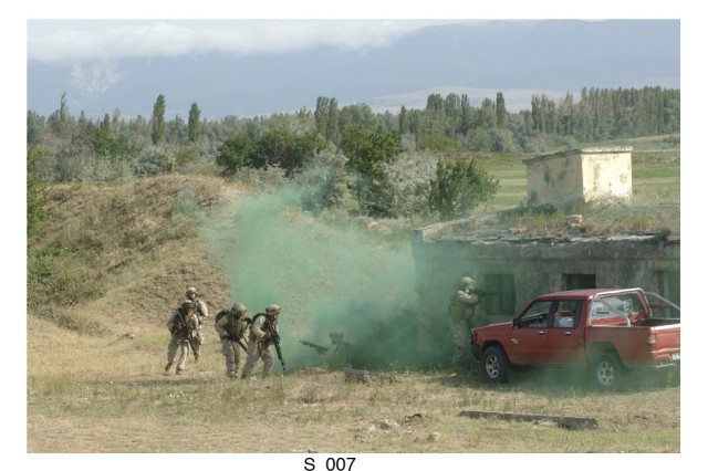 U.S. Marines use urban assault tactics to enter a building at the Vaziani military base in the country of Georgia. Soldiers from SETAF, the Georgia Army National Guard, Marines reservists from Ohio and soldiers from the country of Georgia participated in an exercise designed to build cooperation between the two countries.