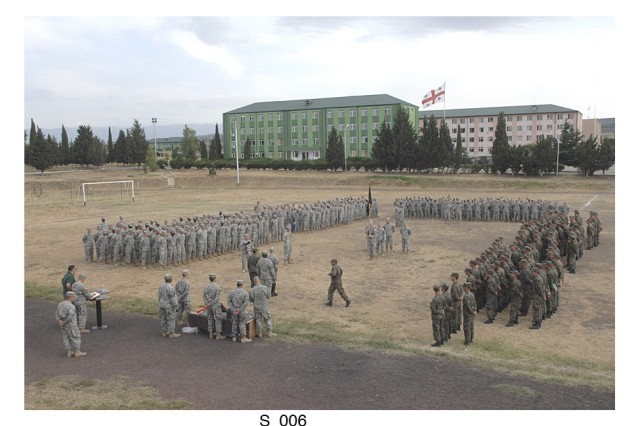 """Soldiers from the U.S. Army's Georgia Army National Guard march into formation next to soldiers from the country of Georgia during a display of partnership during the combined training exercise """"Immediate Response 08."""""""