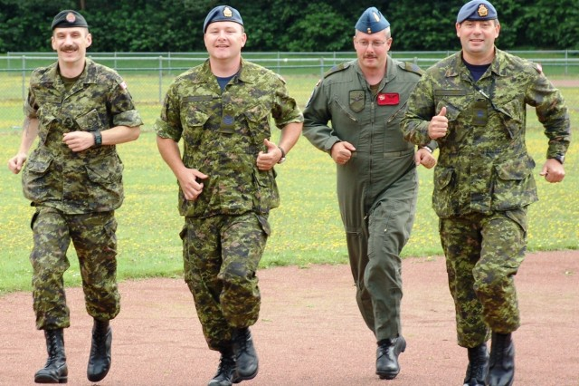 Canadian Air Force  Sgt. Paul Trudel, Sgt. Dean Parsons, Warrant Officer Todd Lake and Sgt. Rod Almrud, members of the Geilenkirchen Canadian Component's Terry Fox Planning Committee, demonstrate a little warm-up form after a planning meeting for their 2008 events.