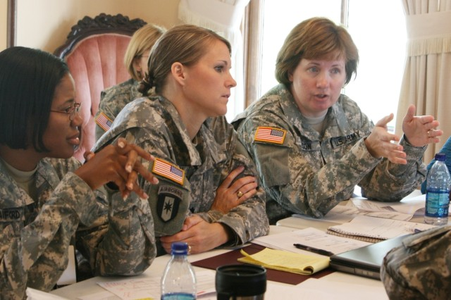 Lt. Col. Kathy Carson (far right), chief of the Clinical Institute for Hospital Education and Staff Development at Womack Army Medical Center at Fort Bragg, N.C., makes a point during the Army Nurse Residency program summit Aug. 6 at the Stilwell House. The Army Nurse Corps is establishing a one-year residency program for its new nurses.