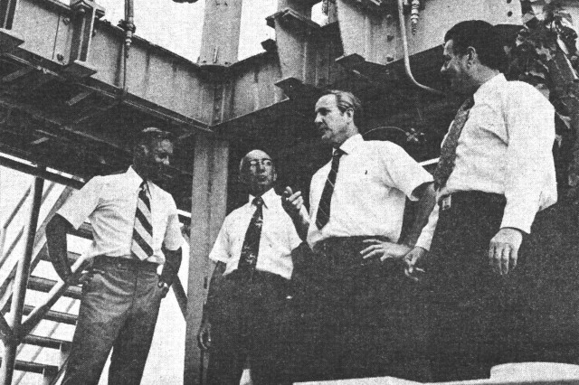 In this 1973 photograph, a younger Bill Pittman, at far right, joins other Redstone rocket team members in front of the rocket's historic test stand. With Pittman at the 20th anniversary of the first Redstone rocket launching are, from left, Russ Gambill, Bill Stripling and John Osborne. The four were among several American engineers and scientists who joined the German rocket team in the 1950s, a collaboration that led to the development of the Redstone rocket and launched the nation's race to space. The engineers first worked for the Ordnance Missile Laboratories and later became employees of the Army Ballistic Missile Agency.