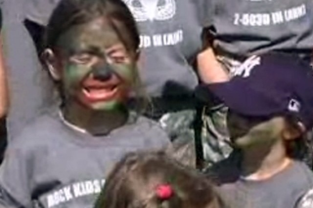 Army children get a taste of Mom and Dad's job - face paint included - in Vicenza, Italy.