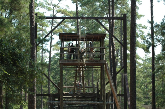 Cadet Elisha Woienski, The Citadel cadet, completes the Slide to Victory obstacle at the Confidence Course Saturday. The cadets had to climb a cargo net then walk across a balance beam before climbing to the top and going down the zipline in a harness.