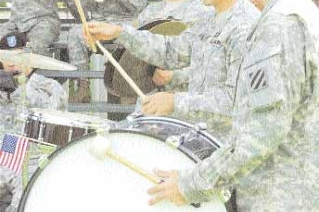 Soldiers of the 3rd Inf. Div. Band perform a number of tunes helping set the atmosphere for the festive welcome home ceremony, Aug. 7 at Cottrell Field.