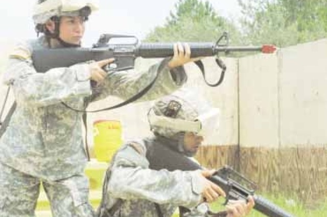 Pvt. Joann Terrell and Pfc. Mark Terrell, 90th Human Resources Battalion, 3rd Sustainment Brigade, practice weapon malfunction techniques during Individual Readiness Training at Evans Field, Aug. 8.