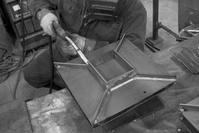 Andy Catlett, a depot welder at Anniston Army Depot, Ala., produces 52 base plates a day during an 11-hour work day. Here, he welds the base plate for a HMMWV jack stand as part of a Rock Island Arsenal, Ill., project.