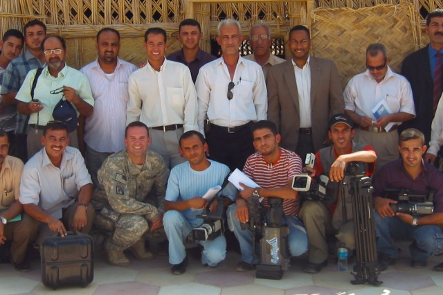 Group photo of the Iraqi journalists, Muthanna PRT members and Soldiers assigned to the 4th BCT, 1st Cav. Div., at Combat Outpost Six, near Samawah Aug. 7.