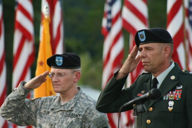 Maj. Gen. Robert M. Radin and Command Sgt. Maj. Stephen D. Blake salute the colors during the Healing Field event.