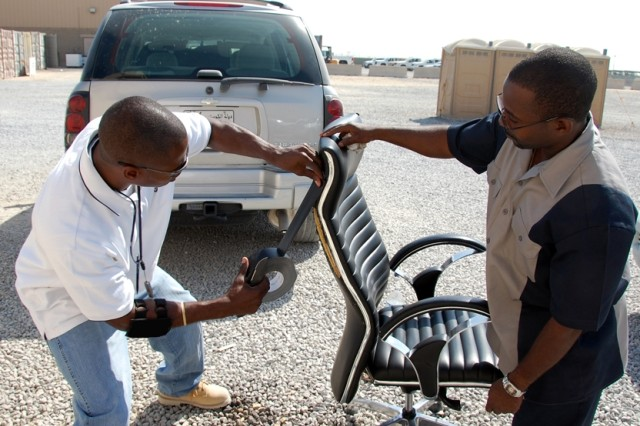 WESTAR Aerospace and Defense Group employees Bernard L. McSmith (L), Army Reset Program supervisory data monitor, and Kelvin Johnson, supervisory data monitor for Sample Data Collection, perform a field expedient repair outside their work area, Saturday, Aug. 9, 2008 at Camp Arifjan, Kuwait.  Data collected by WESTAR is provided to the U.S. Army Materiel Systems Analysis Activity to track the reliability of various warfighting and warfighter support systems being used in Operation Iraqi Freedom and Operation Enduring Freedom.