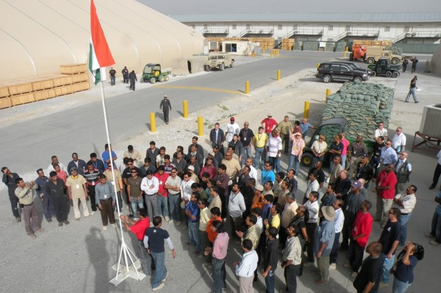 """AGS/AECOM contract workers from India, and other members of the Bagram Airfield Community, witness the raising of the National Flag of India, Aug. 15, 2008, at the Army Materiel Command Compound at Bagram Airfield, Afghanistan.  The ceremony was held in recognition of India's 62nd year of independence from British colonial rule.  Typically, the phrase """"Jai Hind,"""" which is roughly translated as """"long live India"""" is associated with this day.  Among those gathered are AECOM project manager, Heyward O. McLendon, deputy project manager, Todd Starin, director of maintenance Billy Legans, director of Supply Barbara Gillespie, human resources Manager Dwayne Taylor and Keith Smith, supervisor of quality control."""