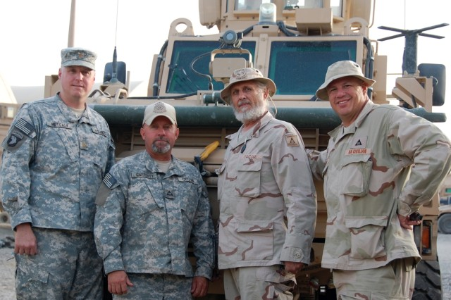 """Members of the """"Task Force Currahee"""" Brigade Logistic Support Team pose in front of an RG-31 Mine Resistant Ambush Protected Vehicle, Aug. 16, 2008, at Forward Operating Base Sharana, Afghanistan. BLST members are (L-R) Maj. Matthew Metcalf, BLST Team Chief; Brian Cafferty, U.S. Army Communications-Electronics Command, Power Generation and Electronics Logistics Assistance Representative; Ralph Smith, U.S. Army Tank-automotive and Armaments Command, Automotive Engineering LAR; and Paul Webb, Joint Munitions Command, Quality Assurance Specialist, Ammunition Surveillance LAR. The Shanara BLST supports the task force built around the 506th Parachute Infantry Regiment of the 101st Airborne Division (Air Assault). The 506th is the unit featured in the television mini-series, """"Band of Brothers."""" Currahee Mountain, part of which is in the Chattahoochee National Forest, was featured during the training of the American Paratroopers at Camp Toccoa, Georgia where they ran up and down Currahee. The name of the mountain became the motto for the regiment, along with the famous quote """"3 Miles up, 3 Miles down."""""""