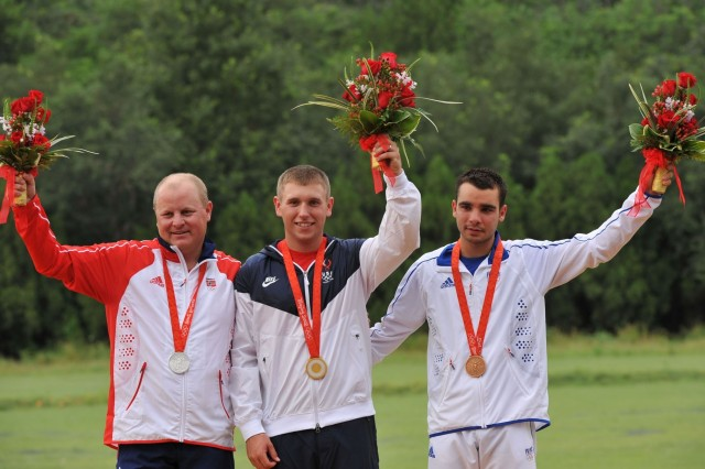 Olympic skeet gold medal winner Pfc. Vincent Hancock (center) of the U.S. Army Marksmanship Unit, is flanked by silver medalist Tore Bovold (left) of Norway and bronze medalist Anthony Terras (right) of Italy on the podium, Aug. 16, in Beijing.