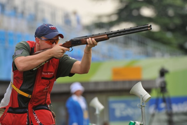 Army Marksmanship Unit shotgun shooter Pfc. Vincent Hancock, 19, of Eatonton, Ga., sets two Olympic records and prevails in a four-shot shoot-off with Norway's Tore Brovold to win the men's skeet competition Aug. 16 at the Beijing Shooting
