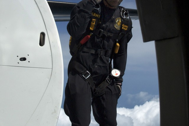 SSG Noah Watts, U.S. Army Golden Knights Parachute Demonstration Team, salutes as he exits the C-31 Fokker 'Friendship' aircraft during a performance for the 50th Annual Chicago Air and Water Show, Sunday, August 17th, 2008.
