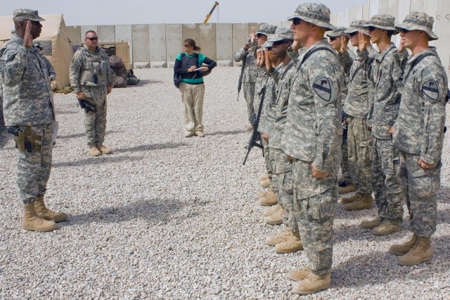 Lt. Gen. Lloyd J. Austin III, reenlists Pfc. Jacob McHenry and other Long Knife Brigade Soldiers at Forward Operating Base Garry Owen, near Amarah, Iraq, July 30.