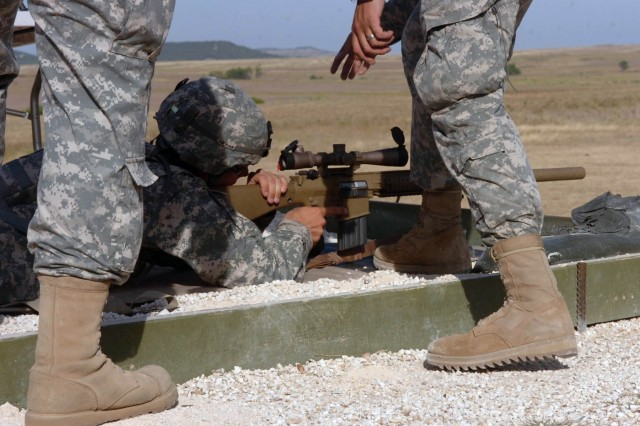 Tyler, Texas native, Spc. Todd Cushatt, artillery mechanic with Headquarters and Headquarters Battery, 1st Battalion, 82nd Field Artillery Regiment takes aim with the new M107 Semi-automatic Long Range Sniper Rifle July 29. The weapons and their systems were designed by Program Executive Office Soldier.