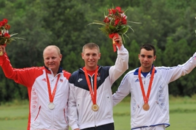 Olympic skeet gold medal winner Pfc. Vincent Hancock (center) of the U.S. Army Marksmanship Unit, is flanked by silver medalist Tore Bovold (left) of Norway and bronze medalist Anthony Terras (right) of Italy on the podium Aug. 16 in Beijing.