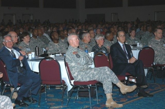 Members of the head table listen to opening remarks at the beginning of the 2008 LandWarNet Conference Aug. 19, at the Broward County Convention Center in Fort Lauderdale, Fla.