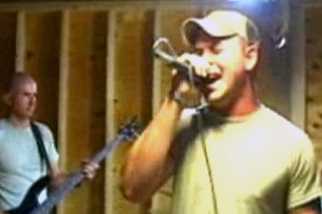 Two members of the band Dead Reckoning, whose members are stationed in Taji, Iraq.
