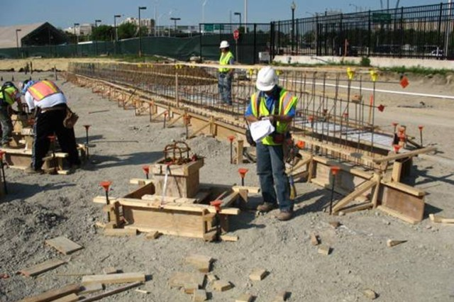 A view of the northwest corner of the Memorial. A field engineer verifies pier form work and rebar ready for concrete pour of the Memorial's foundation