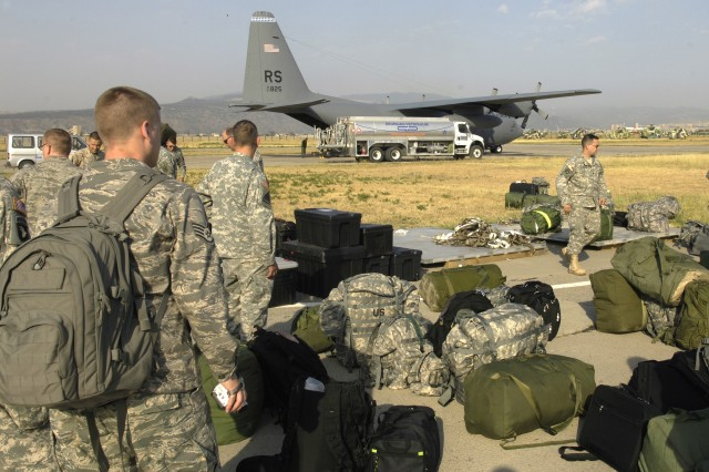 Soldiers and airmen from the 21st Theater Sustainment Command arrive on the flight line in Tbilisi, Georgia, Aug. 18. The 21st is part of European Command's (EUCOM) Joint Humanitarian Assistance Assessment Team and are working closely with other elements of the federal government, international governments, aid agencies and the Republic of Georgia to help bring aid to the Georgian people.