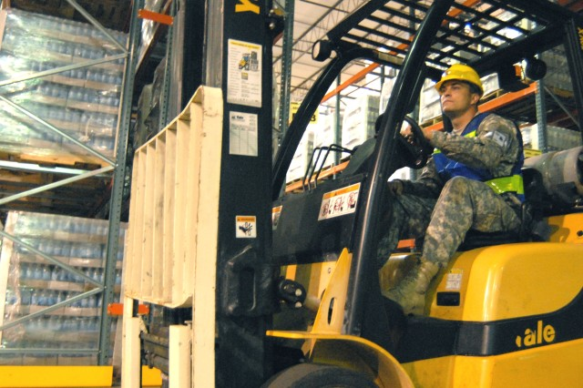 Spc. Bryan Chapman of the 708th Maintenance Company operates a forklift at the State Logistics Resource Center in Orlando, Fla., Aug. 20, loading bottled water for Tropical Storm Fay relief operations.