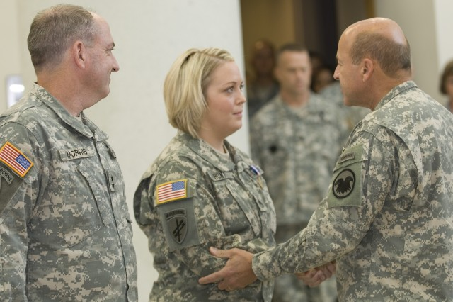 FORT BRAGG, N.C. - Staff Sgt. Jacqueline L. Hunt is congratulated by Maj. Gen. Alan D. Bell, Deputy Commander of the U.S. Army Reserve Command, after being awarded the Department of Defense Soldier's Medal. Looking on is Maj. Gen. David A. Morris, Commanding General of the U.S. Army Civil Affairs and Psychological Operations Command (Airborne). Hunt is an Army Reserve Civil Affairs Soldier assigned to the 490th Civil Affairs Battalion, located in Abilene, Texas.